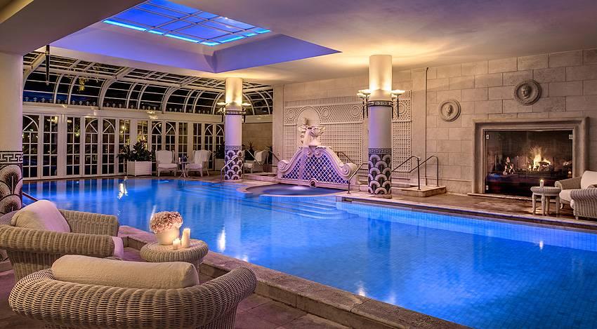 Indoor pool nightime rome hotel cavalieri